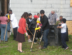 Residents and Volunteers Cleaning Back Yard